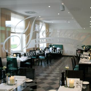A photo of Fleming's Brasserie & Wine Bar im Fleming's Conference Hotel restaurant