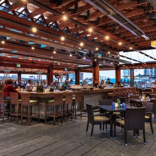 A photo of The Deck Kitchen & Bar at Pacific Gateway Hotel restaurant