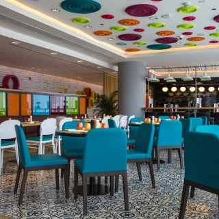 A photo of Live Inn Room Restaurant - Park Inn Hotel in Dubai motor city restaurant